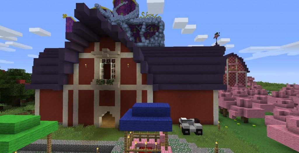 Punainen talo. Talon vieressä on vaaleanpunaisia puita.