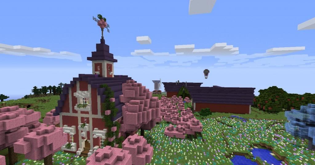 Punaisia rakennuksia ja vaaleanpunaisia puita.