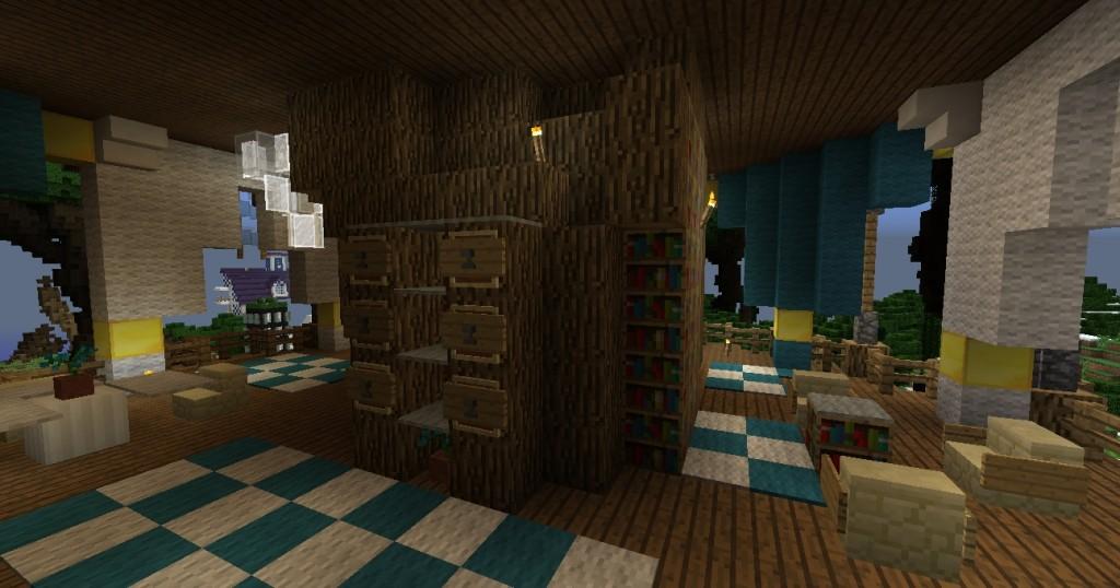 Huone, jossa on huonekaluja ja kirjahyllyjä.