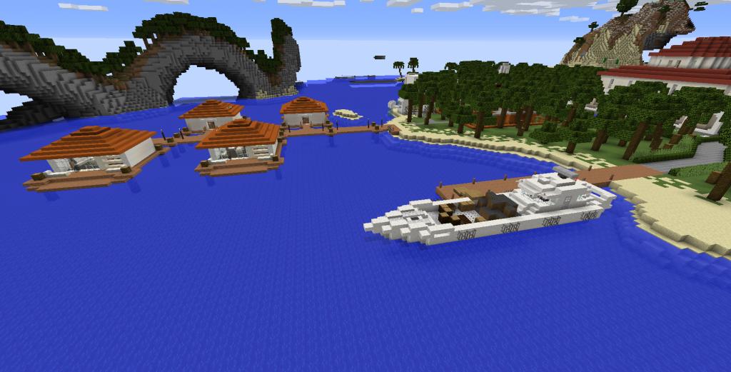 Satamassa on laiva. Veden päällä on laituri ja mökkejä.