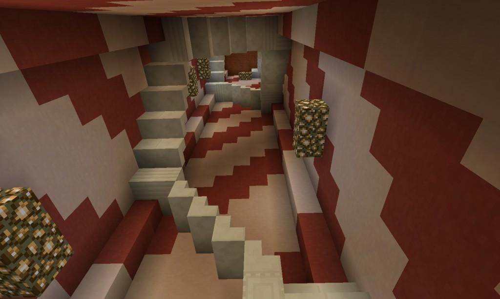 Punavalkoinen huone, jossa on paljon portaita.