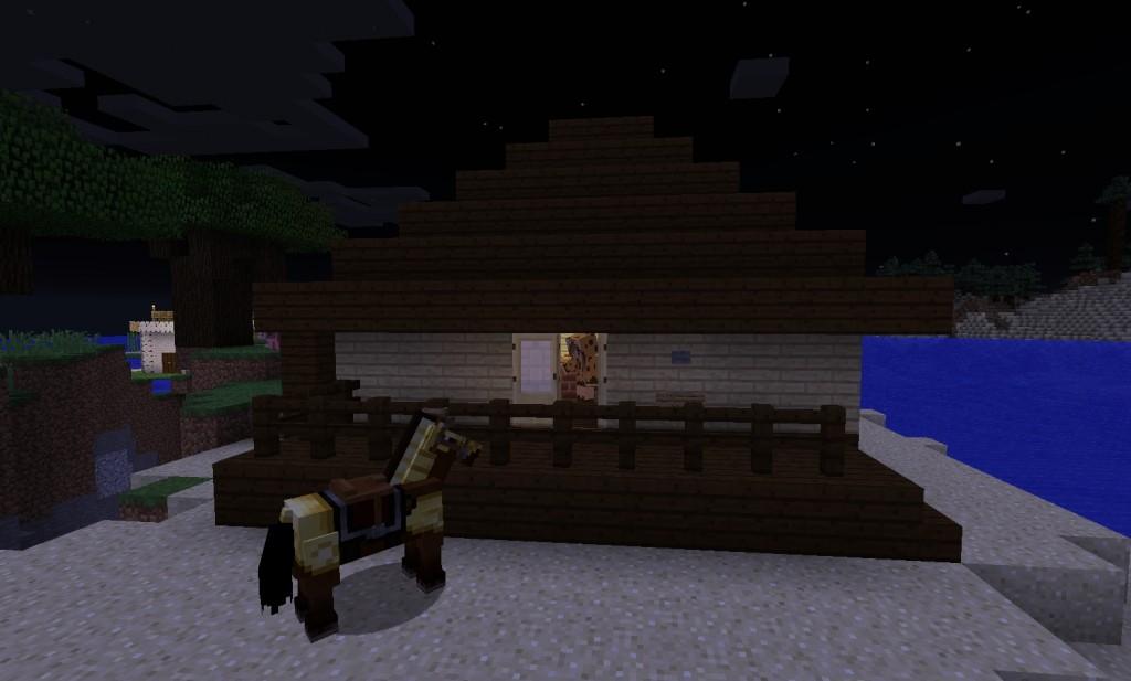 Yö. Talon edessä seisoo hevonen.