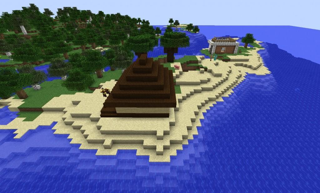 Rakennuksia hiekkarannalla.